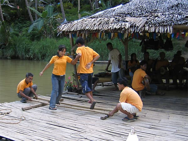 Locals tinikling on Loboc River, Bohol, Philippines