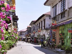 Main street in Vigan, Philippines, with flowers.