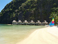 Bungalows on stilts at Miniloc Island Resort, Palawan, Philippines